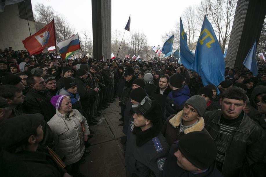 Ukrainian police separated ethnic Russians (left) and Crimean Tatars during rallies near the Crimean parliament building in Simferopol.